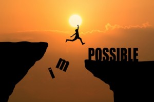 man-jumping-impossible-possible-cliff-sunset-background-business-concept-idea_1323-266
